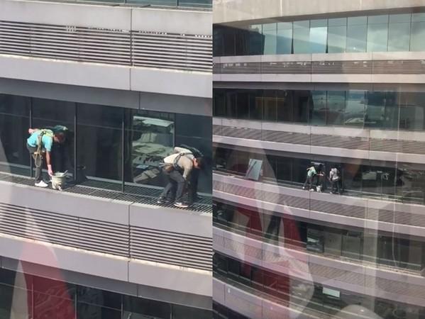 不甩安全繩!20樓外洗窗工「輕快貓步」走玩命伸展台