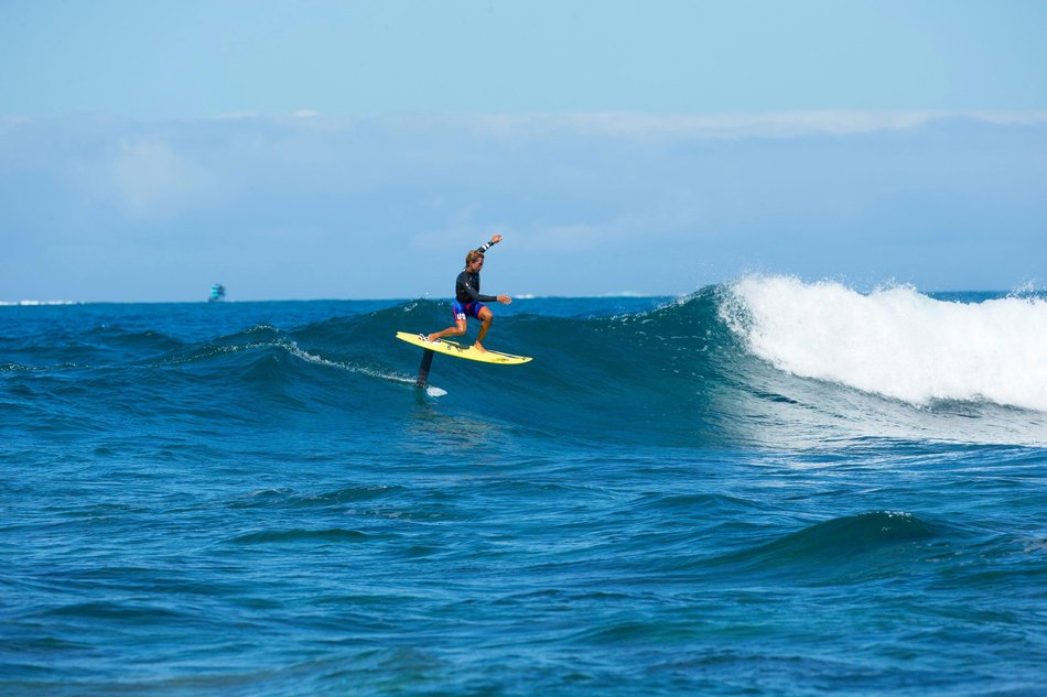 Kai Lenny surfs in Fiji on a hydrofoil surfboard.